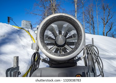 Snow machine gun standing at slope of track on background mountain scenery of the Caucasus mountains on Krasnaya Polyana