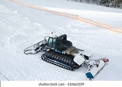 Snow machines on the snow-covered road ski resort.