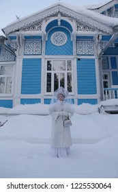 Snow Maiden and wooden house in Tomsk city (Russia)
