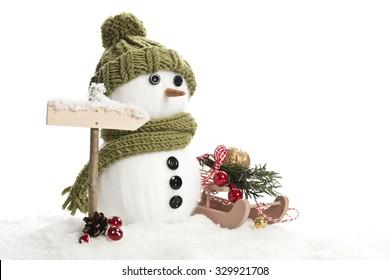 snow man with christmas decoration