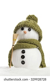 snow man with green bonnet and scarf