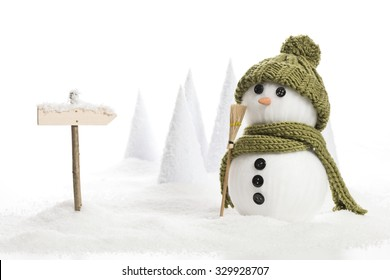 snow man with a sign in a artificial winter landscape
