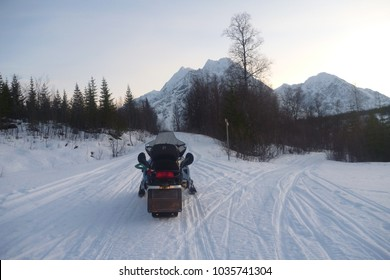 Snow mobile in forest