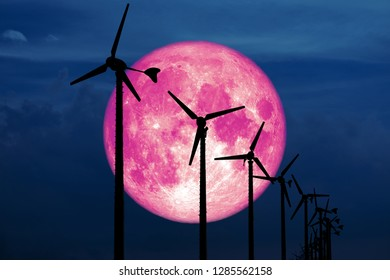 snow moon back Wind turbines produce wind energy which is a clean energy to replace coal and oil energy, Elements of this image furnished by NASA