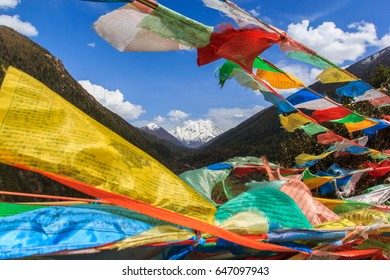 Snow mountain in China Southwestern in Sertar County of Garze Tibetan Autonomous Prefecture, in Tibet, Kham, China, with blurred prayer flags in foreground.