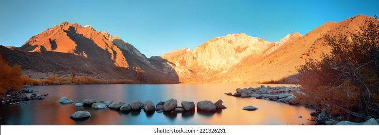 Snow mountain and Convict Lake with reflections in Yosemite panorama.