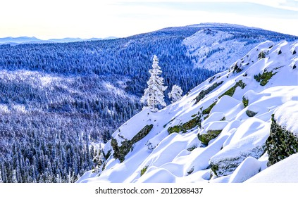 Snow in mountain forests in winter. Snowy mountains. Mountain snow landscape