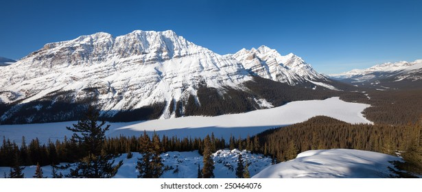 Snow Mountain and Frozen Lake in Canadian Rockies