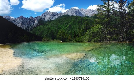snow mountain and lake in Huanglong