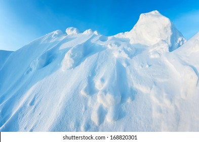 Snow Mountain on a background of blue sky