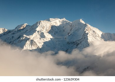 Snow Mountain Peak Landscape / Aerial view of snow covered Mont Blanc mountain peak in winter on the French side of the alps on a clear, blue, cold and sunny winter day.