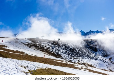 Snow and mountain peaks in the french Pyrenees near Luchon in the Arrondissement of Saint-Gaudens, Occitania, Haute-Garonne, France. The Luchonnais Mountains aerial view.