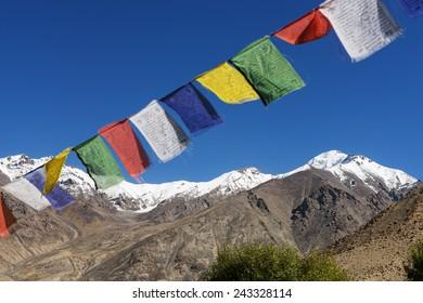 snow mountain range and tibetan prayer flags in the village ,Leh-Nubra Valley Road Ladakh ,India - September 2014