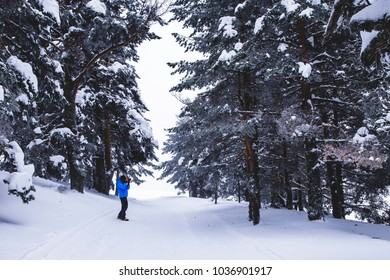 Snow mountain track photography in the forest during winter trekking