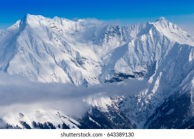 Snow mountains peaks and blue sky