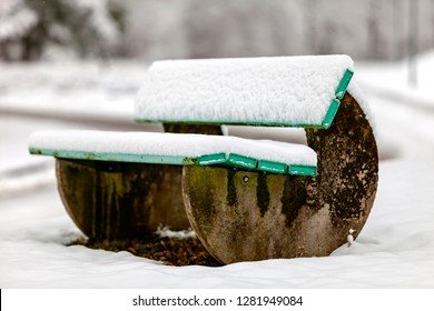The snow now covers the bench as well
