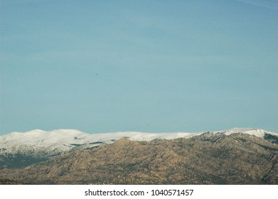 Snow on the Guadarrama mountain range in Madrid (Spain) with La Pedriza on the front.