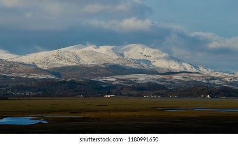 Snow on the hills fells and mountains of the English south lake district.