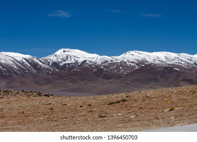 Snow on mountains in arid place