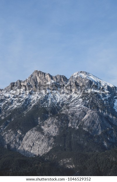 The snow on the mountains melts away on a sunny spring day in Austria. It feels great to see nature blossom again. It might be slow, but it is steady.