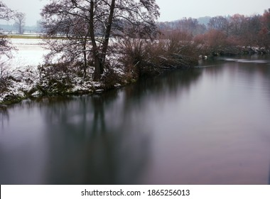 Snow on the sides of a long exposured river