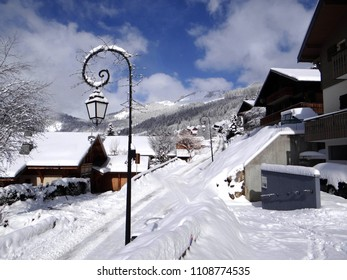 Snow on streetlight in small alpine village, Chatel, France