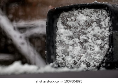 Snow on the windows and mirrors of a car inside view