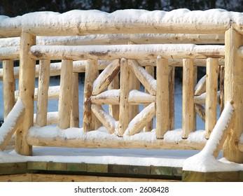 snow on a wooden bridge