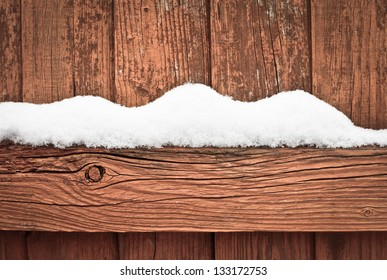 snow on a wooden fence as a background image