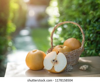 Snow pear or Fengsui pear on the brown wooden table in garden,Fresh Korea pear fruit. Korea pear fresh fruit in the basket  on natural farm background