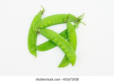 Snow peas on white background.