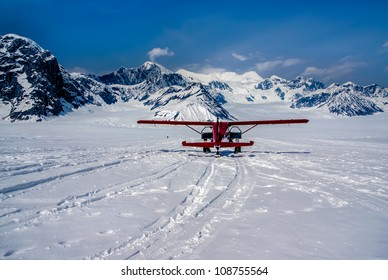Snow Plane Landing on Ruth Glacier in Denali National Park, Alaska.  The Great Alaskan Wilderness.  A Beautiful Snowscape of Rock, Snow, and Ice.
