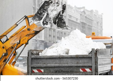 Snow plow outdoors cleaning street