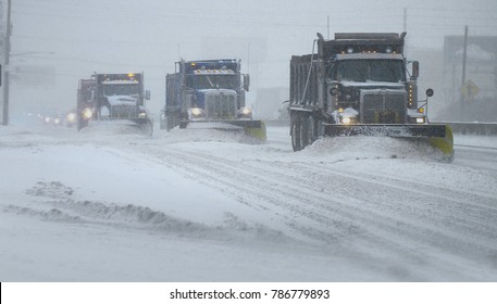 Snow Plows clearing a highway during a snow blizzard