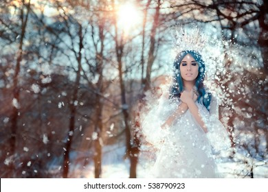 Snow Queen in Winter Fantasy Landscape  - Beautiful princess with ice crown in winter land