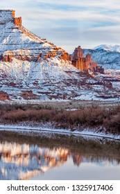 Snow from a recent storm  line the banks of the Colorado and the mesas and mountains surrounding Fisher Towers near Moab, Utah.