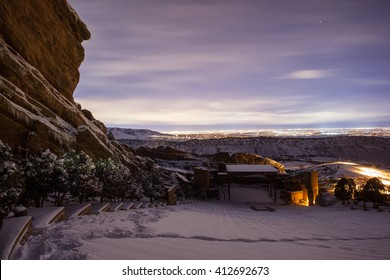 Snow Red rocks amphitheater at night, looking to Denver