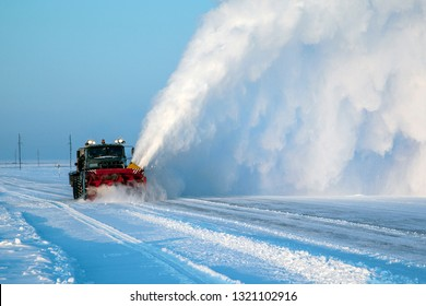 Snow removal machine, road cleaning vehicle, Snow plow doing snow removal after a blizzard