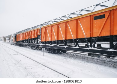 Snow removal train clears railway at the station