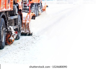 Snow removal in winter. Snow plough trucks clearing road during  winter snowstorm blizzard. Snowstorm