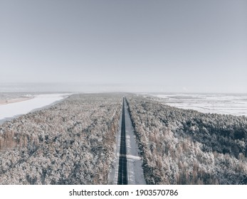 snow road in forest. View at road from sky - Shutterstock ID 1903570786