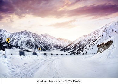 Snow road in the mountains near Big Almaty Lake at sunrise in Kazakhstan