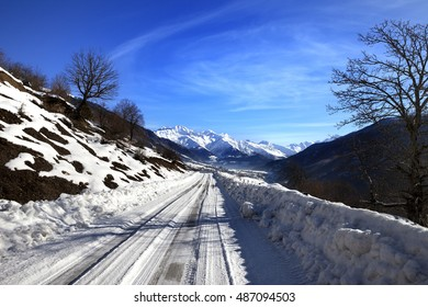 Snow road in winter morning mountain. Caucasus Mountains. Georgia, region Svaneti.