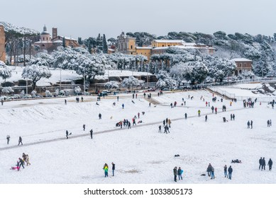 Snow in Rome in February 2018, panoramic view of the Circo Massimo with people playing.