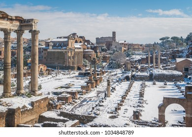 Snow in Rome in February 2018, the Roman Forum with the Colosseum in the background as seen from Campidoglio, Rome, Italy.