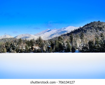 Snow scene with dramatic mountains