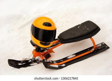 Snow scooter with the orange helmet