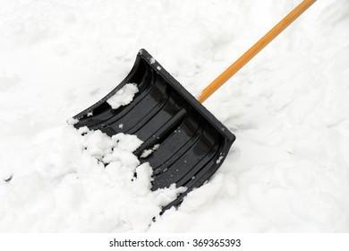 Snow shovel stuck in the snow / Winter service