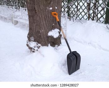 Snow shovel in winter park