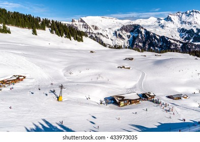 Snow slope in mountain with small slopes for beginners. Ski resort in Alps Switzerland, ''Jungfrau''.
